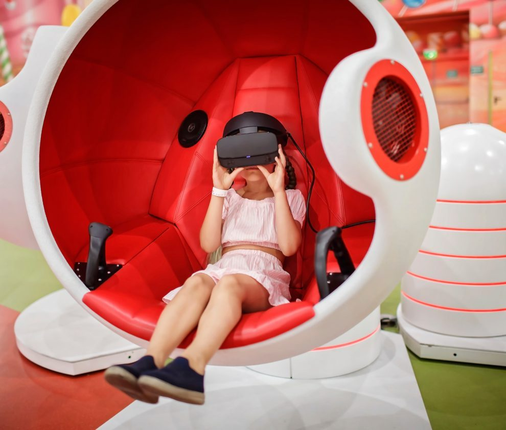 Girl wearing virtual reality googles and experiencing virtual re